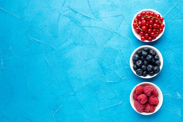 Flat lay of bowls of berries with copyspace Free Photo