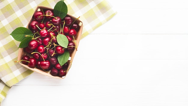 Flat-lay box of berries on tablecloth Free Photo