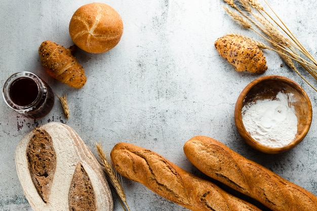 Flat lay of bread and croissants with copy space Free Photo