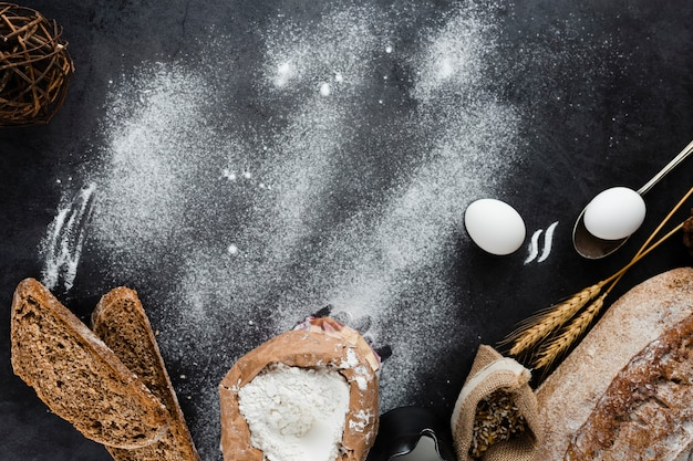 Flat lay of bread ingredients with copy space Free Photo