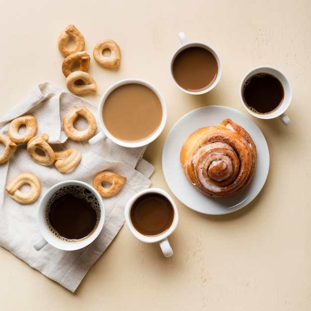 Flat lay breakfast arrangement with coffee and pastries Free Photo