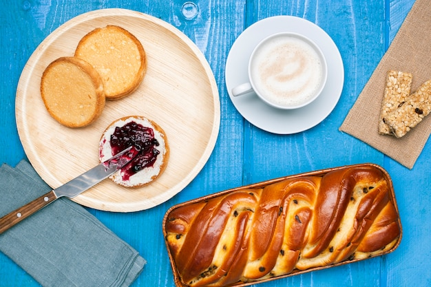 Flat lay brioche with butter jam and orange juice Free Photo