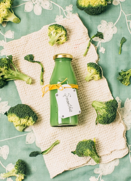 Flat lay broccoli smoothie in a bottle Free Photo