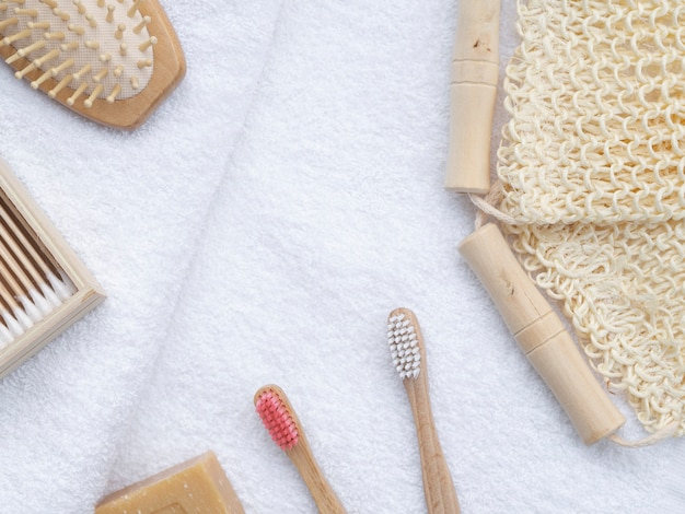 Flat lay brushes and soap on white towels Free Photo