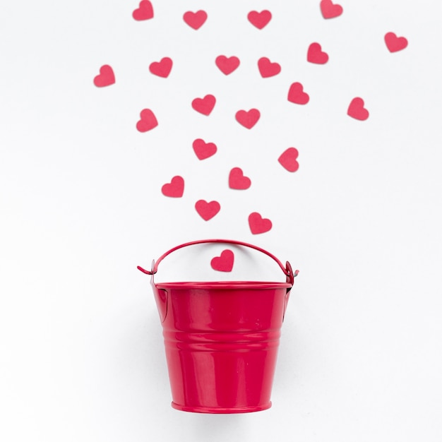 Flat lay of bucket with hearts Free Photo