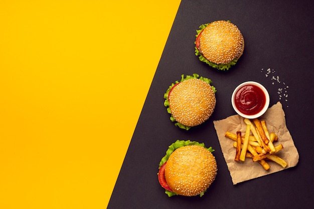 Flat lay burgers with french fries Free Photo