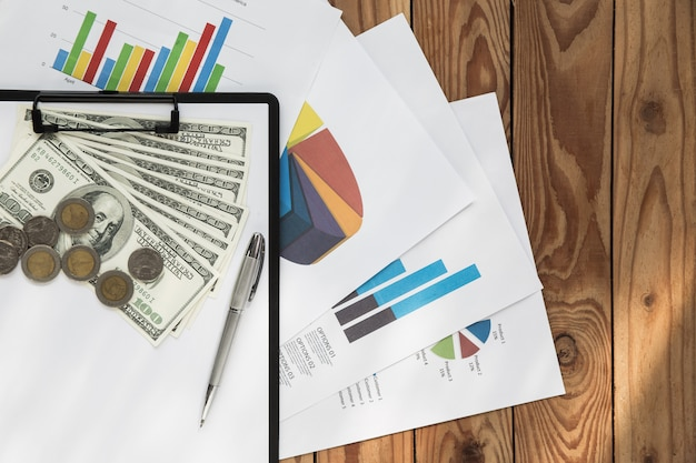 Flat lay business chart on wood background Free Photo