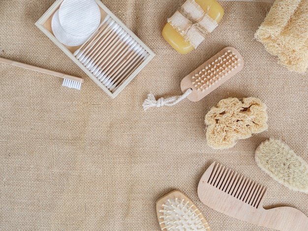 Flat lay care products on sack texture Free Photo