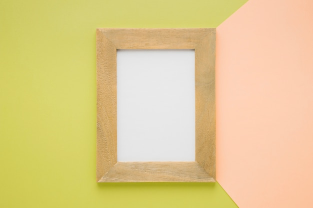 Flat lay centered wooden frame Free Photo