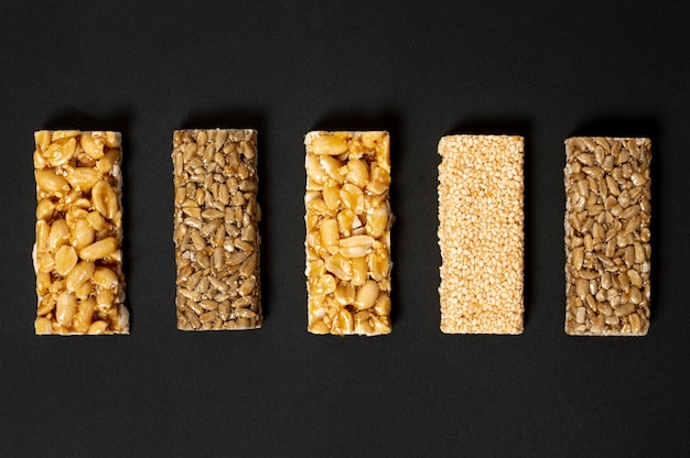 Flat lay  cereal bars assortement on plain background Free Photo
