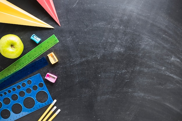 Flat lay of chalkboard and school supplies Free Photo