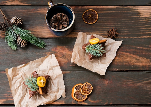 Flat lay of chocolate covered pastry with dried citrus Free Photo
