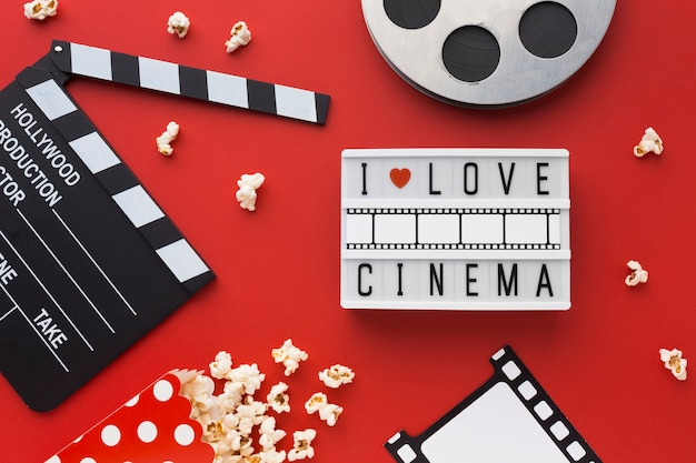 Flat lay cinema elements on red background Free Photo
