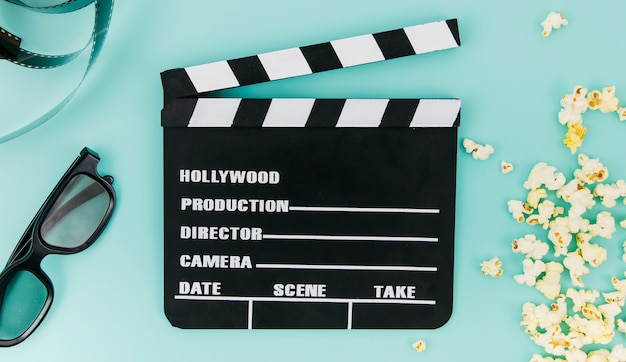 Flat lay of clapperboard for cinema concept Free Photo