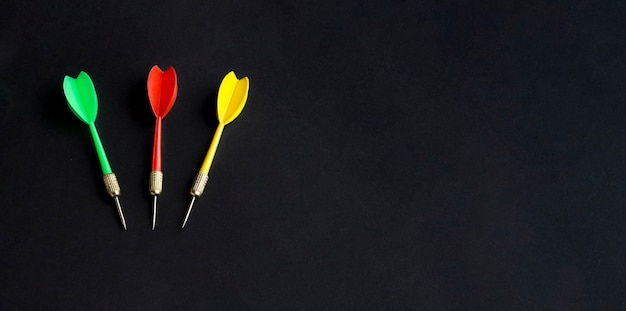 Flat lay of colorful darts with copy space Free Photo
