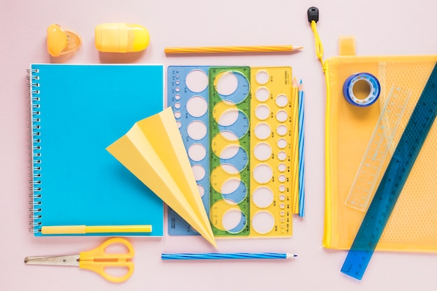Flat lay colorful school supplies Free Photo