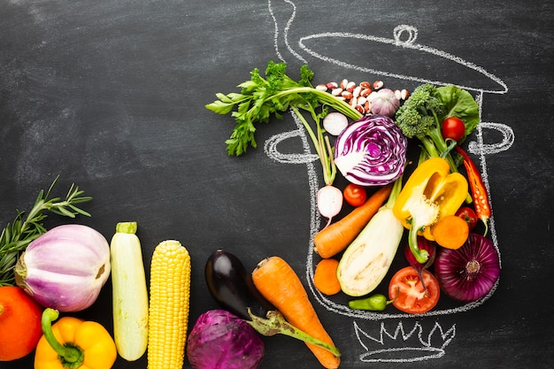 Flat lay colorful veggies on chalk pot Free Photo
