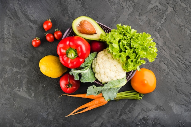 Flat lay composition of healthy vegetables Premium Photo