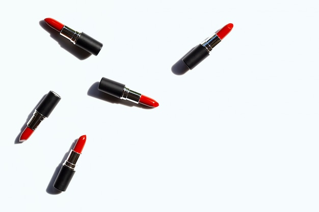 Flat lay composition, lipsticks on white with shadow. beautiful make-up concept Premium Photo