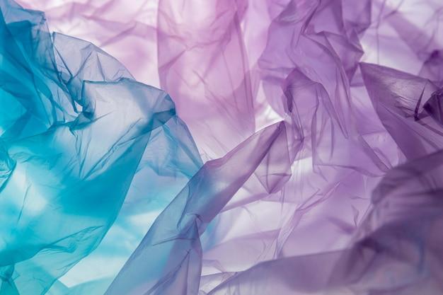 다른 색깔의 비닐 봉지의 평평한 위치 구성 무료 사진