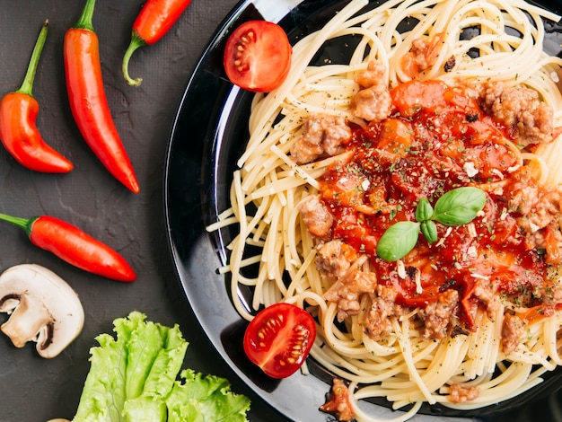 Flat lay composition of pasta bolognesa Free Photo