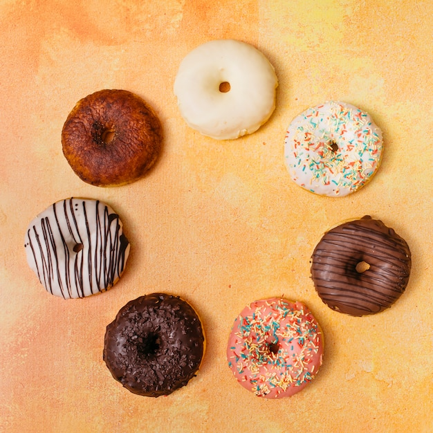 Flat lay composition of tasty donuts Free Photo
