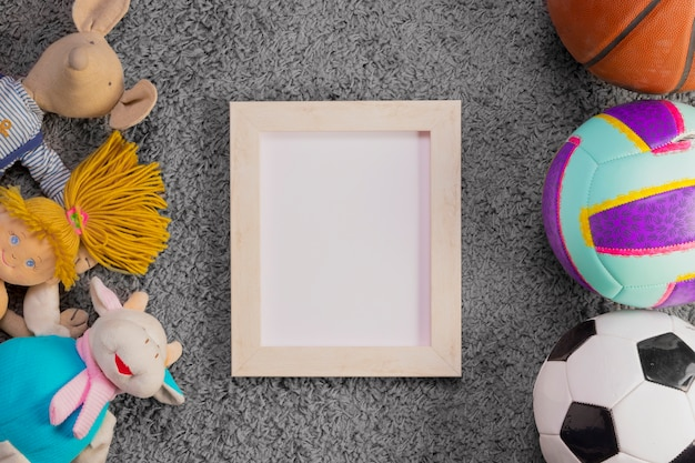 Flat lay composition of toys and frame template Free Photo