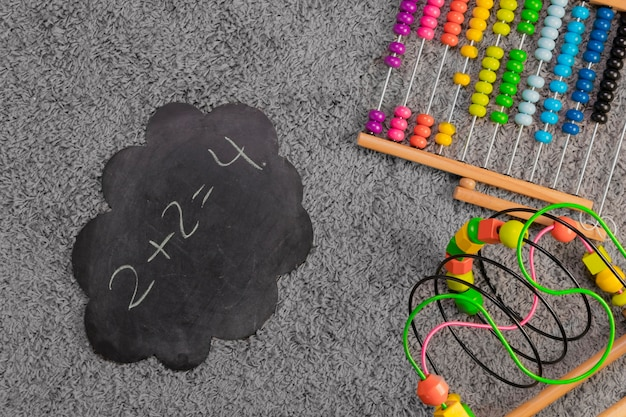 Flat lay composition of toys and slate template Free Photo