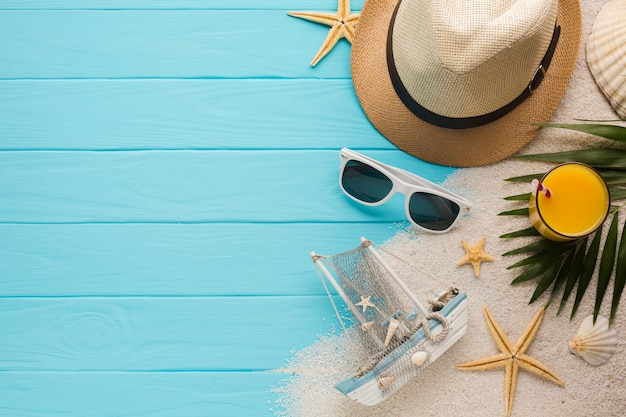 Flat lay composition with beach accessories Free Photo