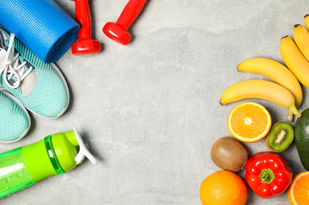 Flat lay composition with healthy lifestyle accessories on grey background Premium Photo