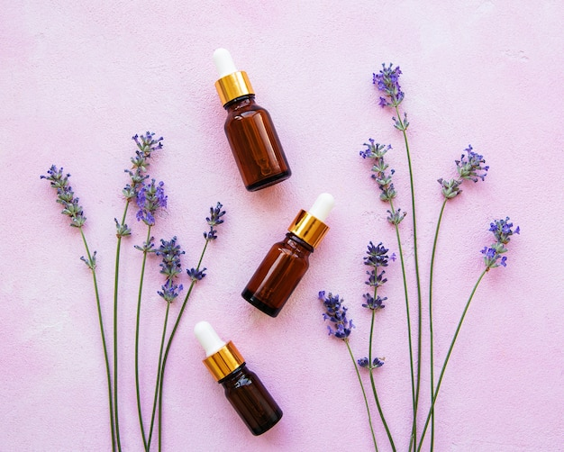 Flat lay composition with lavender flowers and natural cosmetic Premium Photo