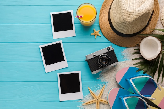 Flat lay composition with polaroid photos and beach accessories Free Photo