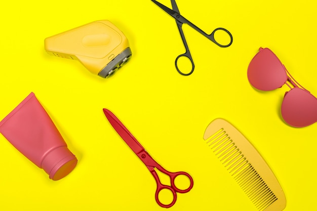 Flat lay composition with professional hairdresser tools on color background Premium Photo