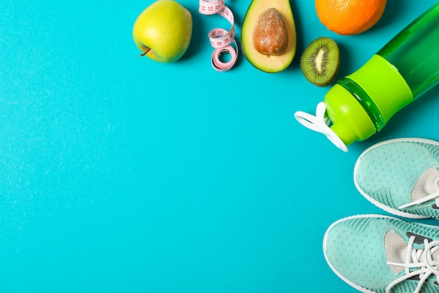 Flat lay composition with sport lifestyle accessories on color background Premium Photo