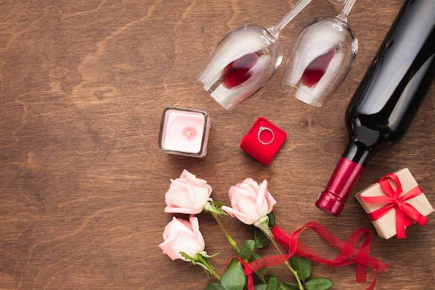 Flat lay composition with wine and engagement ring Free Photo