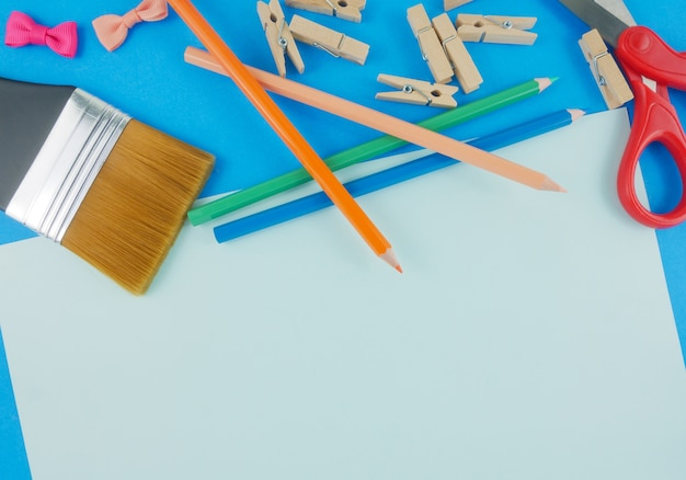 Flat Lay Craft Tools Stationery On Blue Background With Copy Space