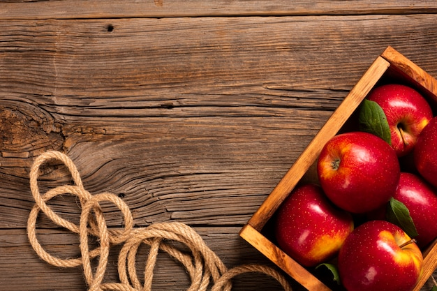 Flat-lay crate with ripe apples with copyspace Free Photo