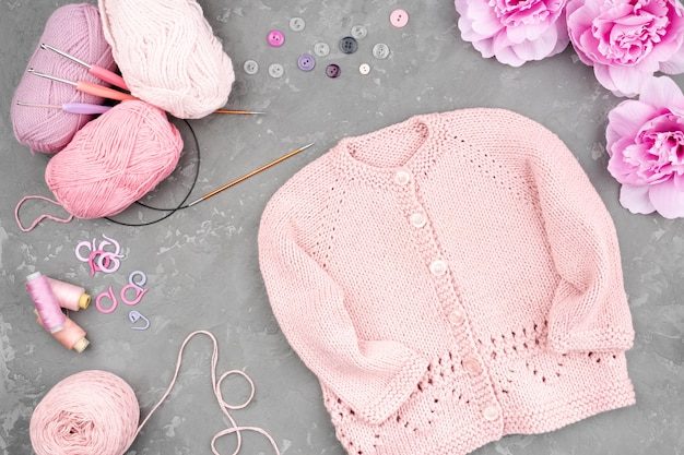 Flat lay of crocheted pink jacket Free Photo