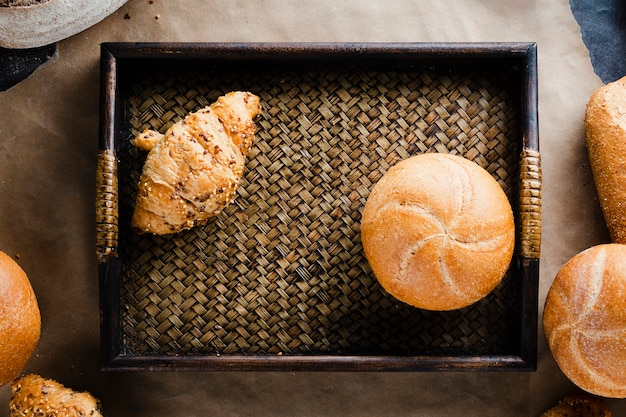 Flat lay of croissant and bread in a basket Free Photo
