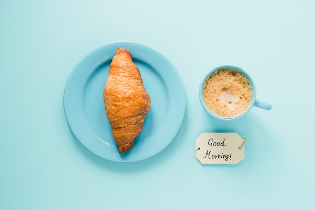 Flat lay croissant on plate with coffee Free Photo