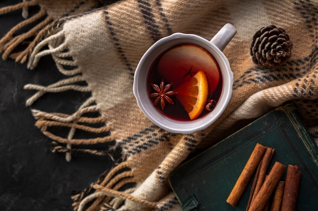Flat lay cup with mulled wine and condiments Free Photo