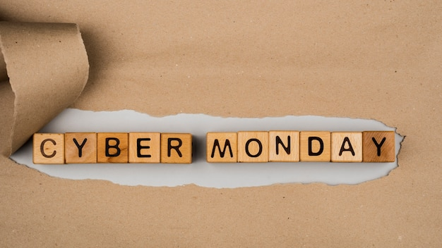 Flat lay of cyber monday word on craft paper Free Photo