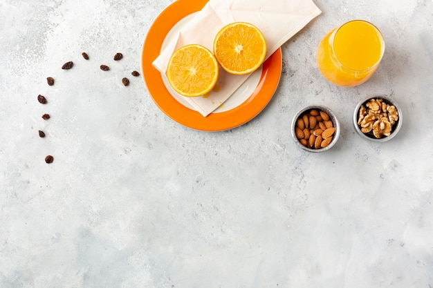 Flat lay decoration with juice and nuts in bowls Free Photo