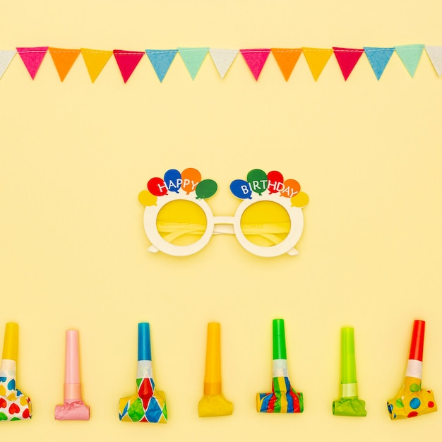 Flat lay decoration with party glasses and blowers Free Photo