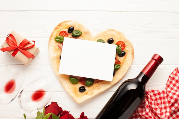 Flat lay decoration with pizza and card Free Photo