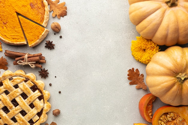 Flat lay decoration with pumpkins on stucco background Free Photo