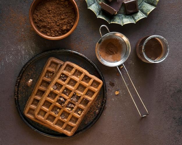 Piatto di laici deliziosi waffer colazione Foto Gratuite