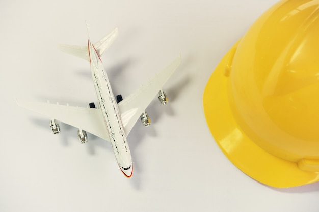 Flat lay design of travel concept with plane on gray background with copy space. Premium Photo