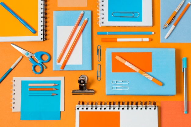 Flat lay desk arrangement with notebook Premium Photo