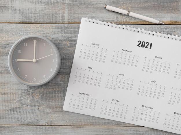 Плоский настольный календарь и аналоговые часы Бесплатные Фотографии